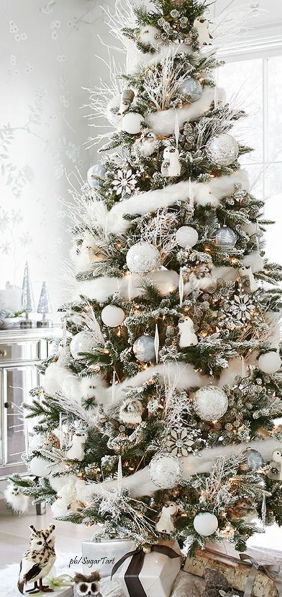 Stunning White Christmas Tree Ideas To Decorate Your Interior 40