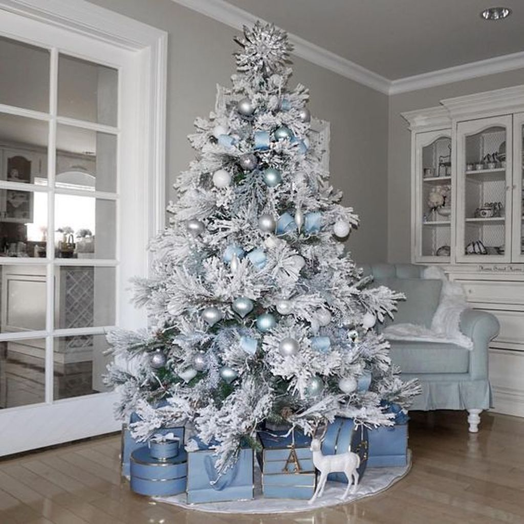 Stunning White Christmas Tree Ideas To Decorate Your Interior 41