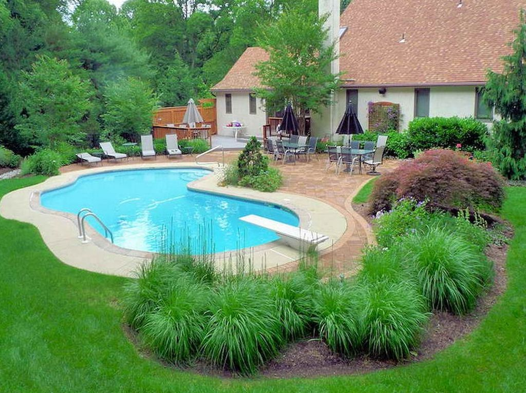 Lovely Swimming Pool Garden Ideas To Get Natural Accent 19