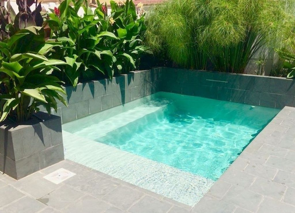 Lovely Swimming Pool Garden Ideas To Get Natural Accent 27