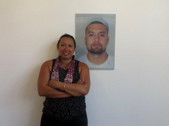 """Leilani Kake with her work, """"MALE - Maori or Polynesian"""" (2014) // Photo courtesy of PIMPI"""