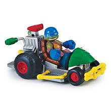 Véhicule + Figurine 6 cm Tortues Ninja - Leonardo Véhicule avec son et un personnage de 6 cm.Chaque véhicule a une fonction et un son propre Véhicule adapté pour les jeunes enfants.