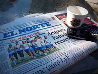 Every morning on the patio...mt coffee, the newspaper and my phone