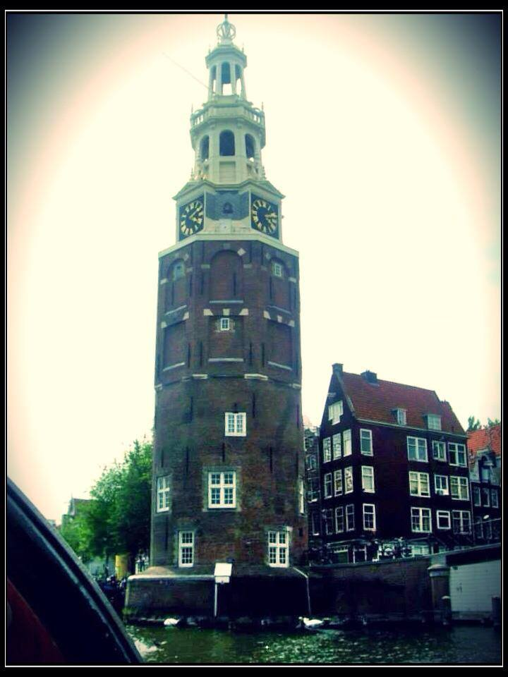 A period tower along Amsterdam Canal, amsterdam canal cruise