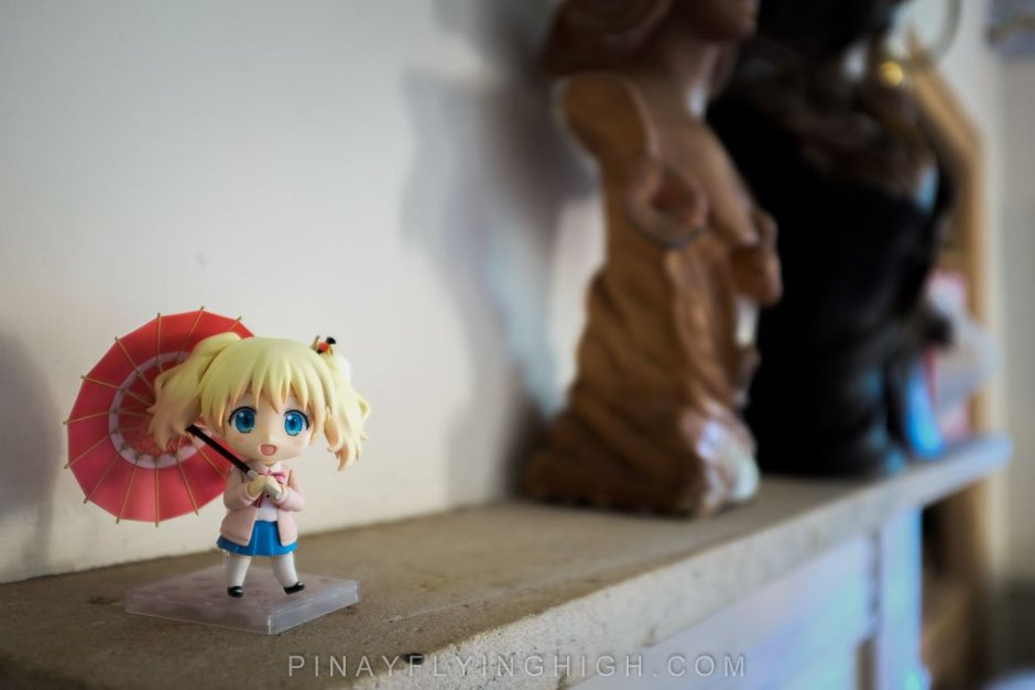 An anime figurine displayed in Fosse Farmhouse's receiving area.