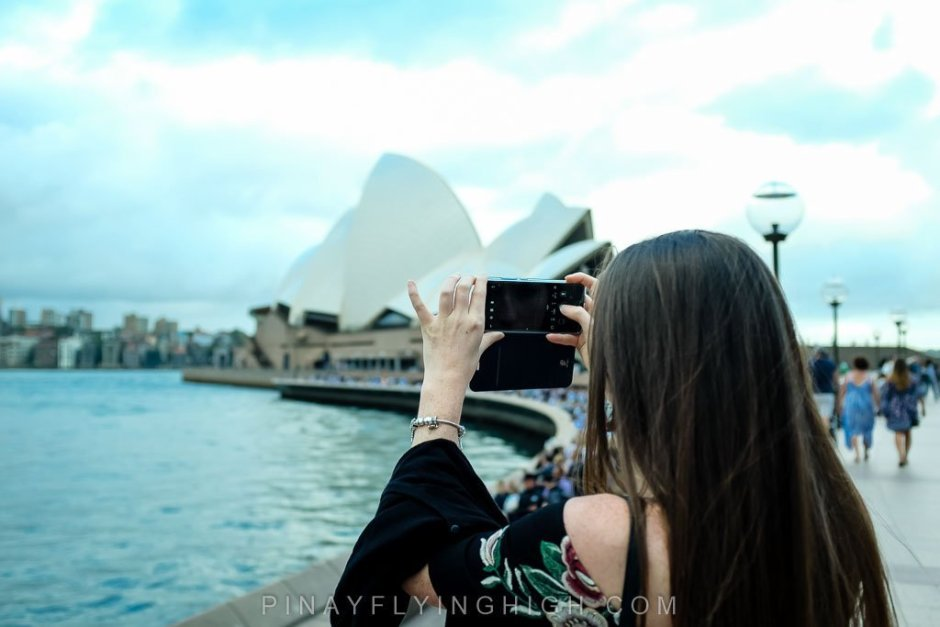 Girl taking a photo in Sydney Harbour