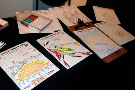 Various attendees at a fundrasing even for the alley mural project colored and drew to celebrate Phoenix arts.