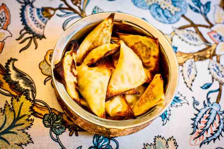 These samosa's are crisp and golden brown on the outside with fluffy, curried spiced potatoes and peas on the inside. Definitely a crowd pleaser!