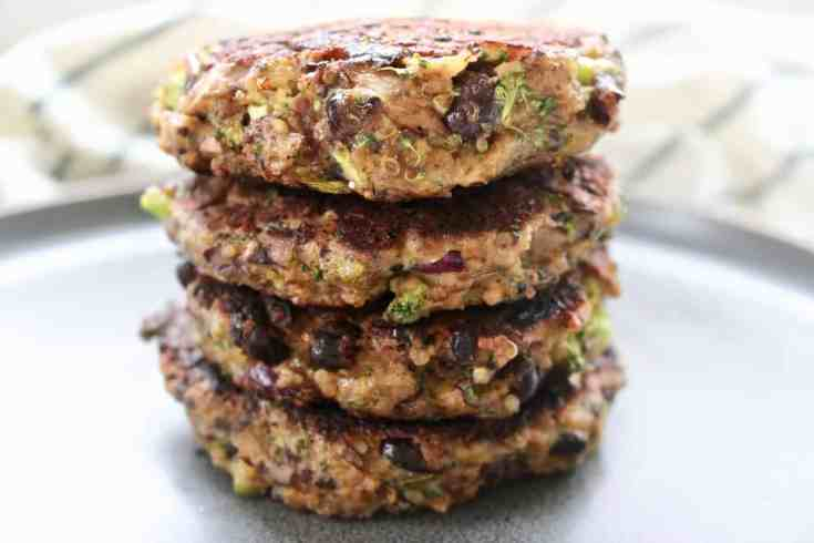 The most amazing black bean veggie burgers!  Protein packed black beans, hearty portobello mushrooms mixed with delicious veggies and grilled to perfection!  These burgers are delicious, meaty and so good you will want to make them all the time!  Vegetarian and gluten-free!