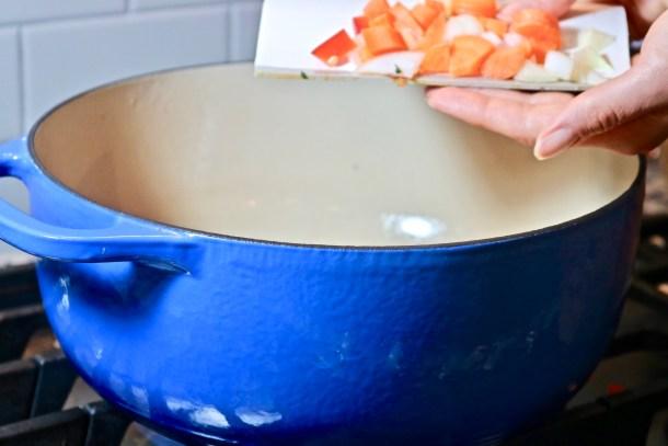 Adding veggies to soup photo