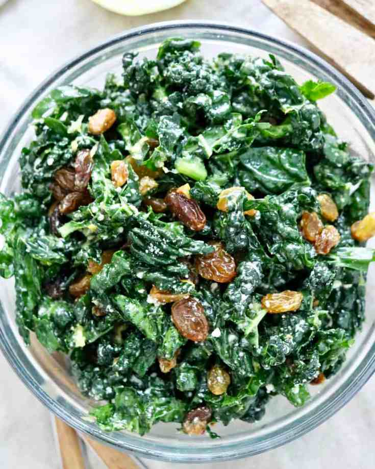 Tangy, crunchy, full of incredible lemon flavor mixed with the amazing superfood KALE! This recipe is the best one you will find for Kale salad. #easykalesalad #lemondressing #kalesaladrecipes #healthymealpreprecipes #vegetariansaladrecipes
