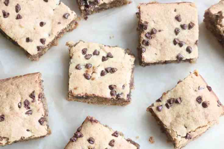 Light, buttery, decadent chocolate chip blondies made from almond flour, coconut oil, eggs, sugar and vanilla mixed with mini chocolate chips. Gluten-free and so easy to make! #Glutenfreedessert, #almondflour, #blondies, #easydesserts