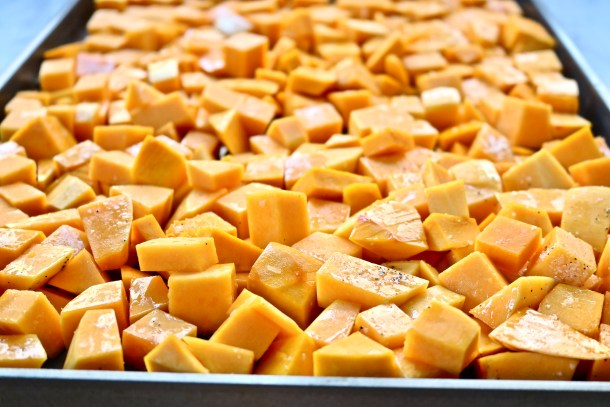 Cubed butternut squash on a pan