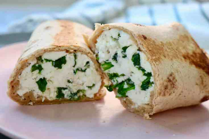 Protein packed egg whites mixed with hearty spinach and creamy feta cheese. This is the BEST way to start your day! #spinachfetawrap #lowcarbbreakfast #easyhealthybreakfastrecipe
