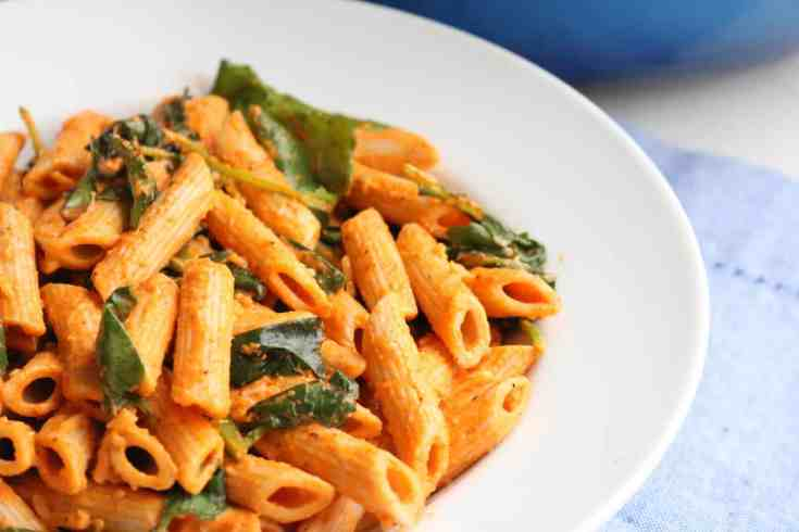 Hearty whole wheat penne covered in a bold roasted red pepper sauce that is creamy and packs a big punch of peppery and garlic flavor.  Add in some baby kale and you have a healthy vegetarian pasta dish your family with LOVE!