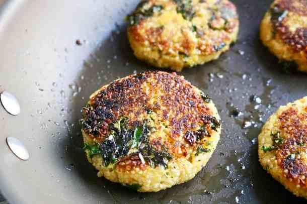 Quinoa patties cooking in pan