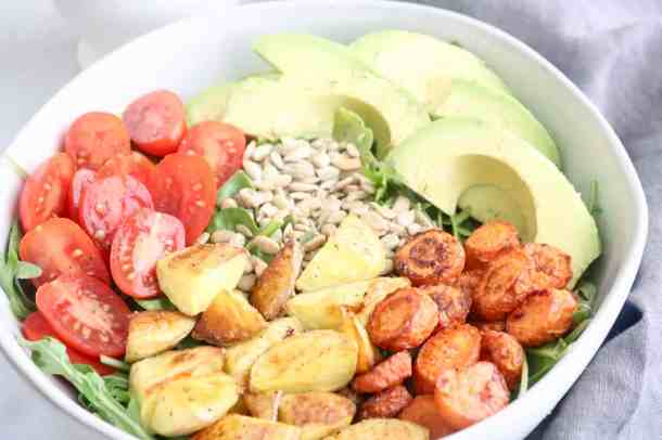 Spinach Arugula Salad with Roasted Vegetables prepped in a salad bowl