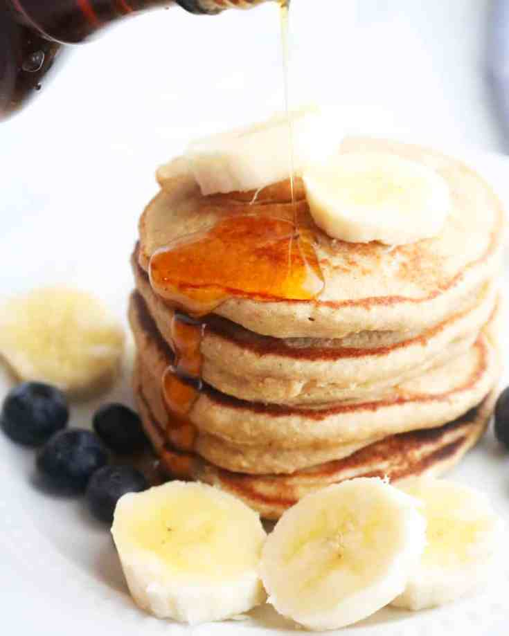 Skinny Banana Oatmeal Pancakes:  Oats, bananas, eggs, cinnamon and vanilla blended perfectly and then poured onto a hot skillet.  Pancake heaven! Soft and fluffy, full of fiber, protein and vitamins, comes together in minutes. Paired perfectly with fruit and warm maple syrup. Lower in carbs and calories and super easy to make!!!! #skinnybananapanckaes, #bananas, #oats, #oatmeal, #fluffypancakes, #Easybreakfastrecipe