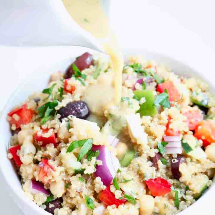 Pouring dressing onto quinoa salad