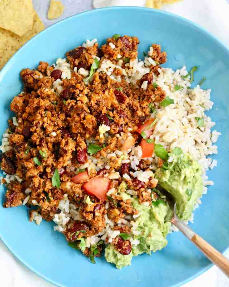 A Vegan Sofritas recipe that is spicy, savory, tofu-free and so good! Packed with all that chipotle flavor and meaty texture necessary in a dish like this. Made from real whole ingredients, super easy to make and a family friendly recipe the kids will go crazy for! Vegan and Gluten-Free! #vegansofritasrecipe #sofritas #cauliflowerrice #walnuts #easyvegandinners