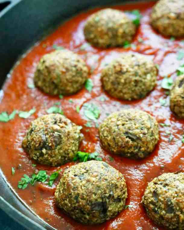 Meatless meatballs in pan of tomato sauce
