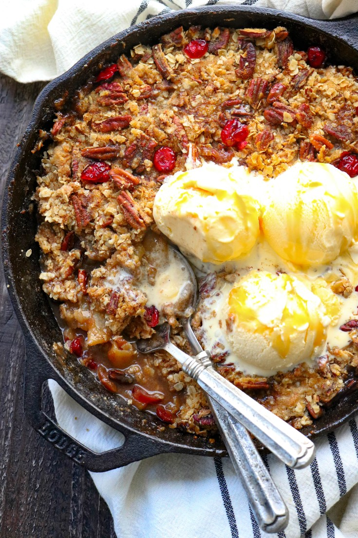 Gluten-Free dutch oven apple crisp that is super easy to make, and truly the best way to make apple crisp. A mix of tart and sweet apples, topped with an incredibly crunchy, sweet topping and baked until golden brown with bubbly, caramelized edges. A dessert recipe your family will go crazy for! #glutenfreedesserts #applerecipes #apples #easyhealthydesserts