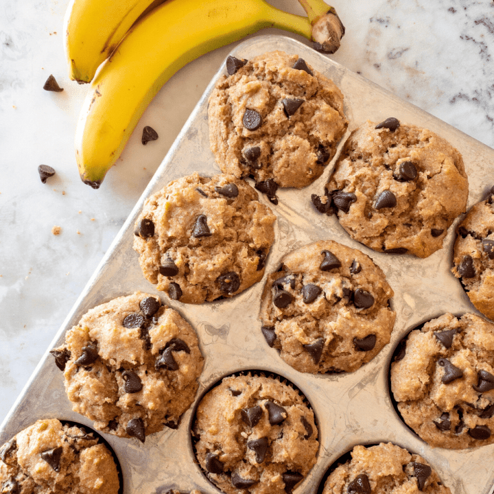 Gluten free banana chocolate chip muffins in a muffin tin