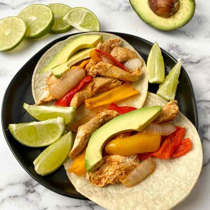 healthy Instant Pot Chicken Fajitas on corn tortillas
