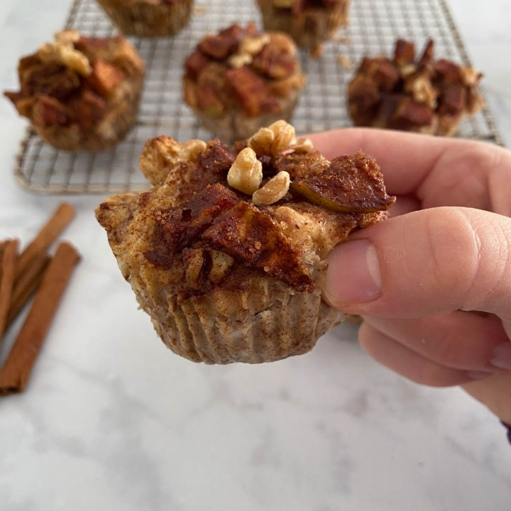 person holding a baked French Toast Muffins