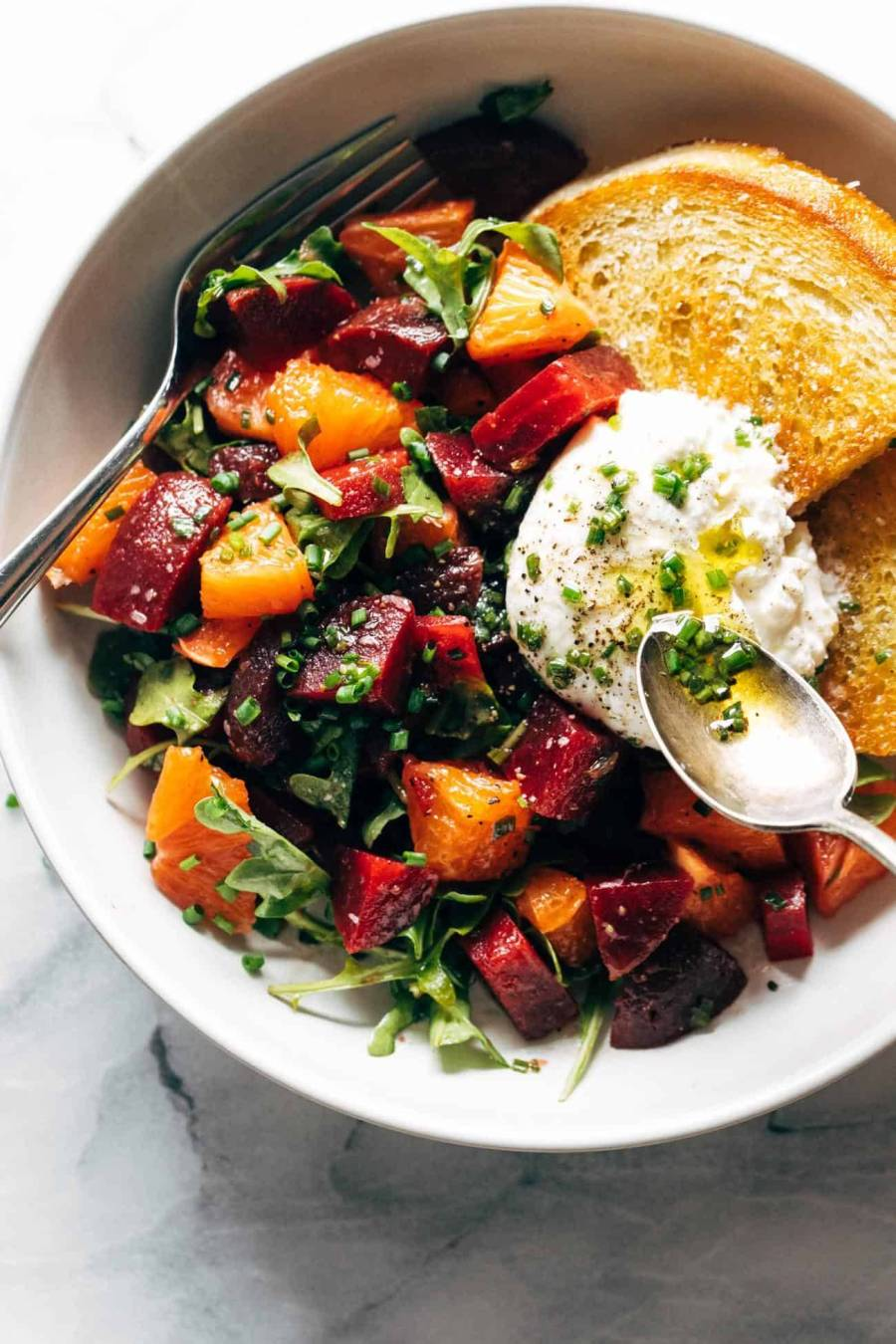 Beet and burrata salad in a bowl with fried bread
