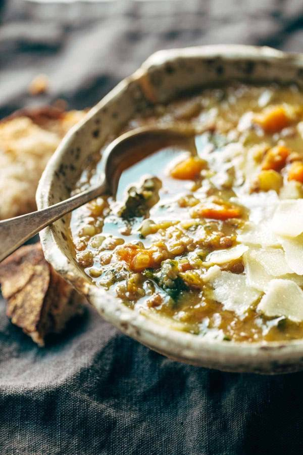 Lentil soup in a bowl with a spoon.