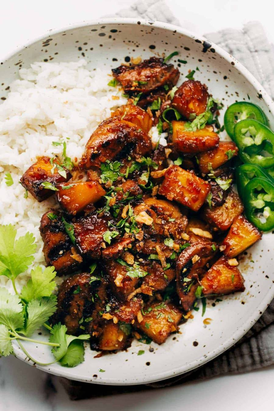 Pineapple pork with coconut rice on a plate