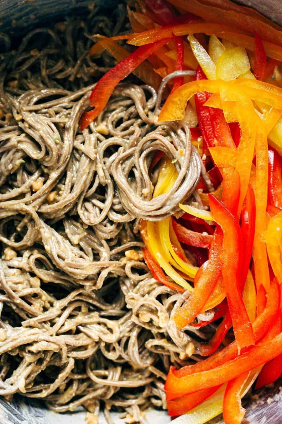 Close-up of soba noodles and bell peppers.