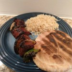 Picture of baharat kabob served with rice and pita