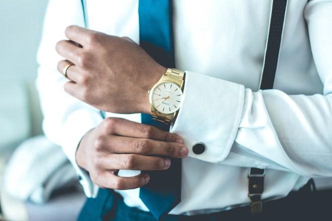 Man wearing a shirt and a gold watch