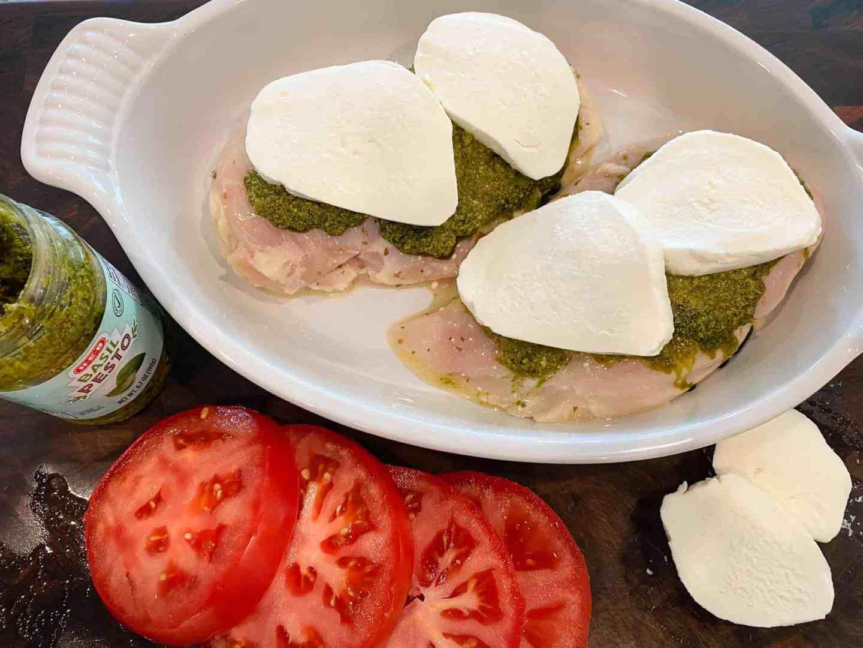place-mozzarella-slices-over-pesto