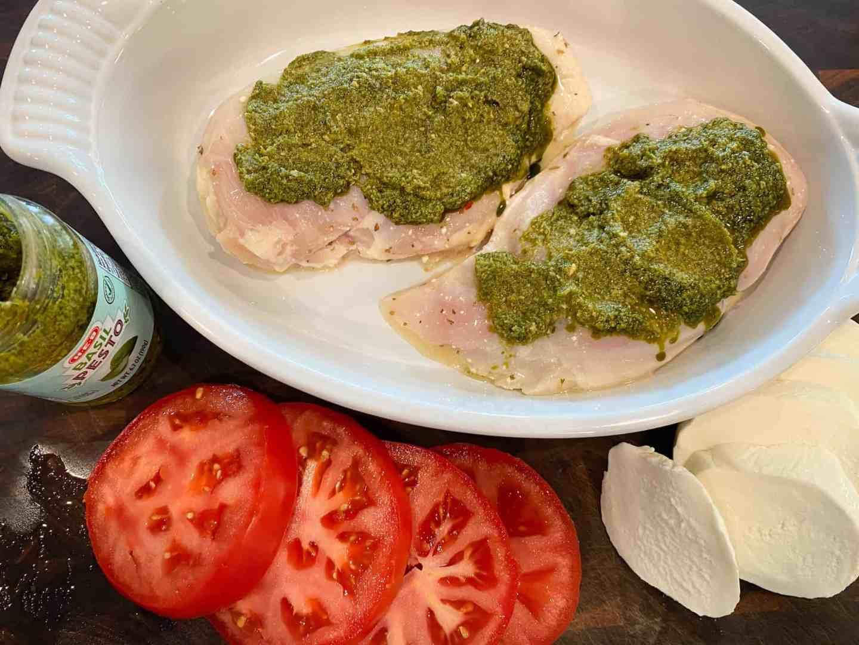 spread-basil-pesto-over-chicken