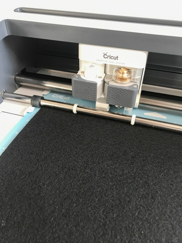 Cricut Maker cutting Black Felt for DIY Black Cat Mask by Pineapple Paper Co.