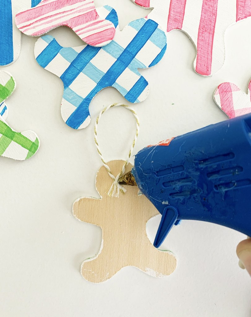 DIY Gingerbread Ornaments cut out of wood with the Cricut Maker by Pineapple Paper Co.