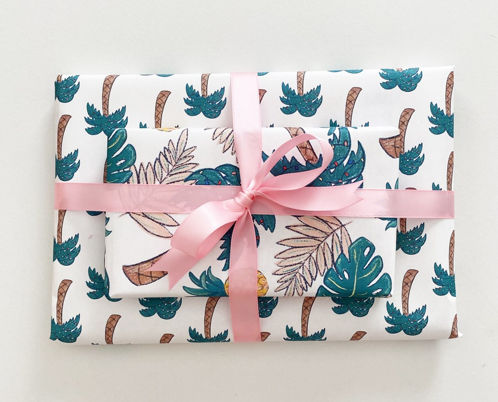 Tropical Printable Wrapping Paper tied with Light Pink Ribbon