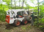 Bobcat had the concrete mixer on front