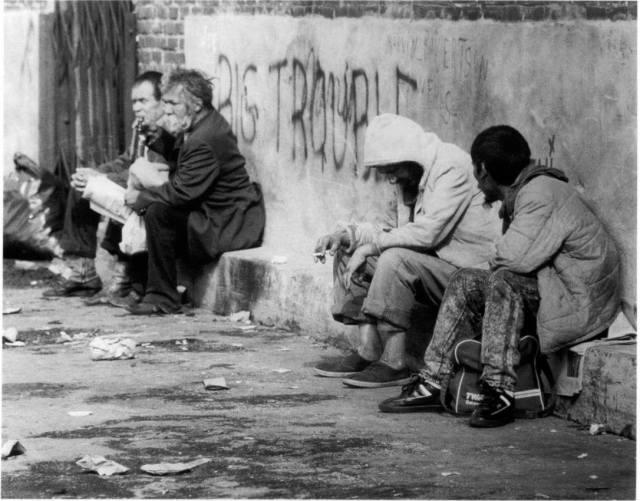HomelessSittingBySidewalk