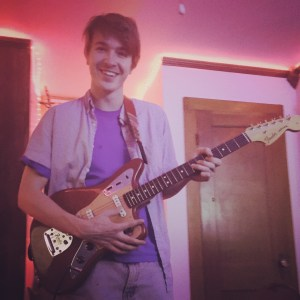 Chris playing a Fender Jaguar.