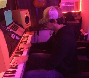 Steve recording and playing piano at Pinetop Recording Studios