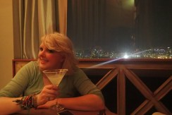 The bright city lights from the panoramic bar