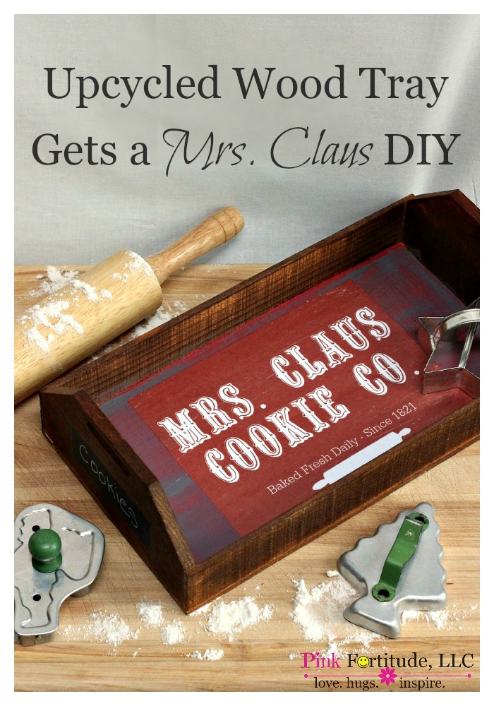 Upcycled Wood Tray Gets a Mrs. Claus DIY by coconutheadsurvivalguide.com. I've been hanging onto this old Fetzer crate for awhile, waiting for the perfect opportunity to upcycle it. I'll take you through the steps for the DIY to make the Mrs. Claus Cookie Co tray, and send you to the source for a free printable. Who is ready to leave out some milk and cookies for Santa?