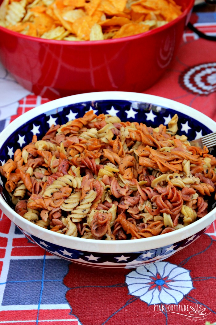 Does it get any more summer comfort food than a delicious pasta salad? If you want to whip up a quick and easy recipe for your summer picnic or potluck, this one is it. And PS - it's red, white and blue for your patriotic 4th of July and Memorial Day parties. Plus it's gluten free, dairy free, vegan, and made with whole foods and clean ingredients. Time to start cooking!