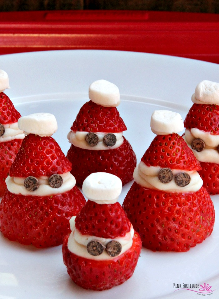 Sometimes at the holidays, you need to serve a treat for kids of all ages. These strawberry Santasare just that. They even have little strawberry Santahats! They are made to be dairy free and vegan, and are naturally gluten free. It's a Christmas dessert and sweet treat for all! See how they are made... #christmas #strawberry #vegan #pinkfortitude