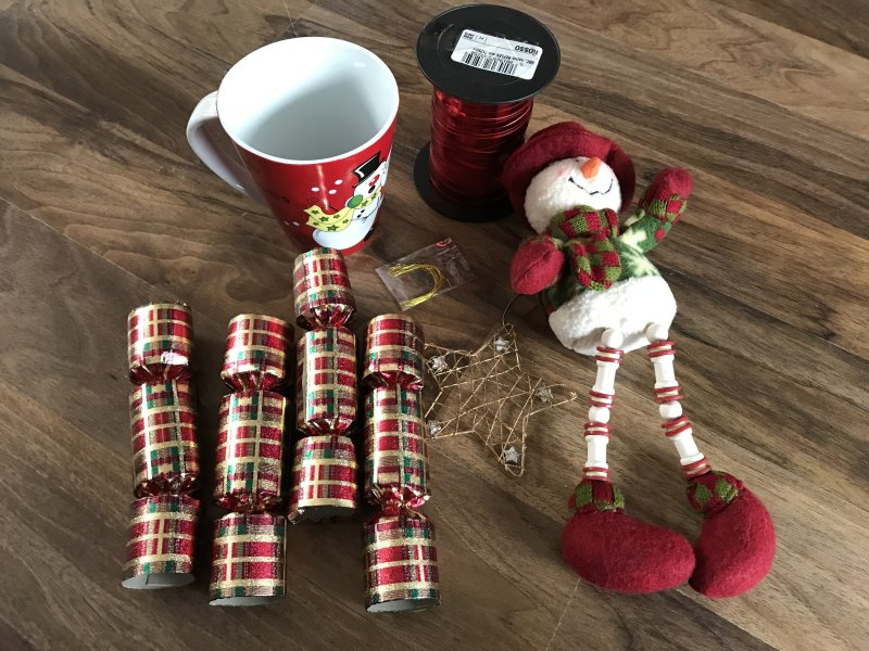 Zero Waste Christmas crackers, cup teddy, star decoration and red twine all taken from Emmaus to reuse as a new gift