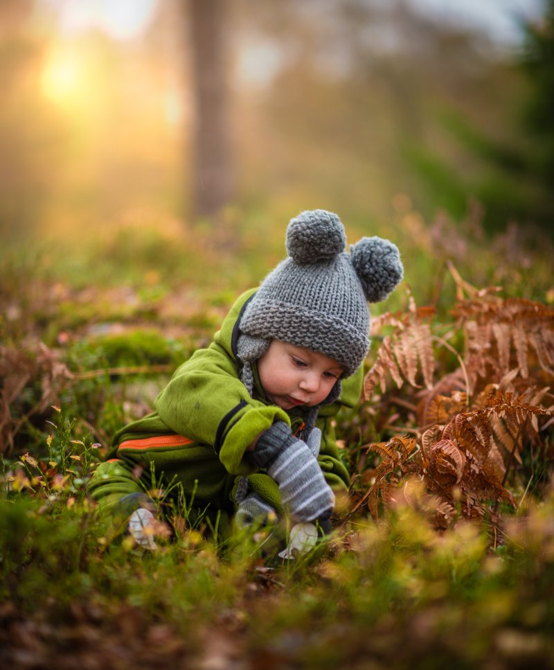 child exploring nature